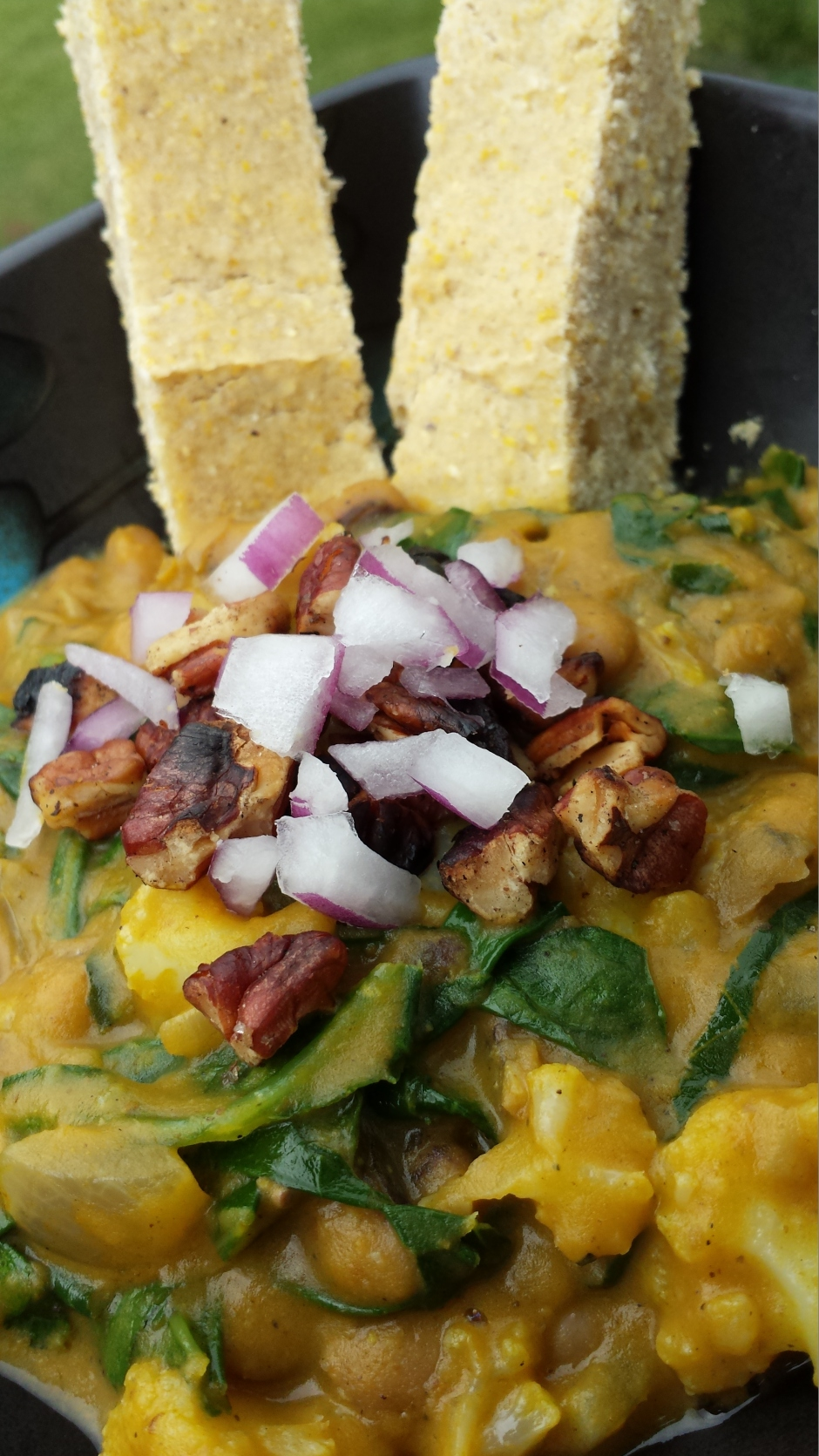 NC - Indian Fusion Black-eyed Pea and Collards Curry w/Coconut Milk and Pumpkin, topped with toasted pecans and red onions. Served with a no-egg version of Bob's Red Mill Cornbread #vegprodrev #veganmofo #vgnmf15